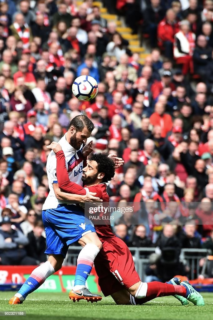 Liverpool's Egyptian midfielder Mohamed Salah (R) vies with Stoke City's Dutch defender Erik Pieters during the English Premier League football match between Liverpool and Stoke City at Anfield in Liverpool, north west England on April 28, 2018. (Photo by Paul ELLIS / AFP) / RESTRICTED TO EDITORIAL USE. No use with unauthorized audio, video, data, fixture lists, club/league logos or 'live' services. Online in-match use limited to 75 images, no video emulation. No use in betting, games or single club/league/player publications. /