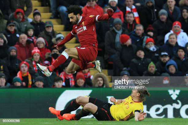 Liverpool's Egyptian midfielder Mohamed Salah vies with Watford's Austrian defender Sebastian Prodl during the English Premier League football match...