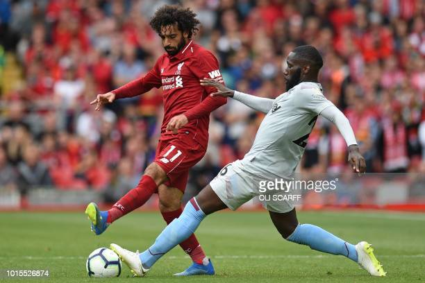 Liverpool's Egyptian midfielder Mohamed Salah vies with West Ham United's French defender Arthur Masuaku during the English Premier League football...