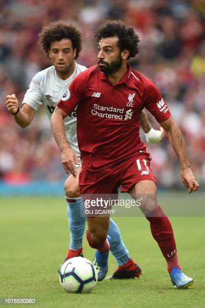 Liverpool's Egyptian midfielder Mohamed Salah vies with West Ham United's Brazilian midfielder Felipe Anderson during the English Premier League...