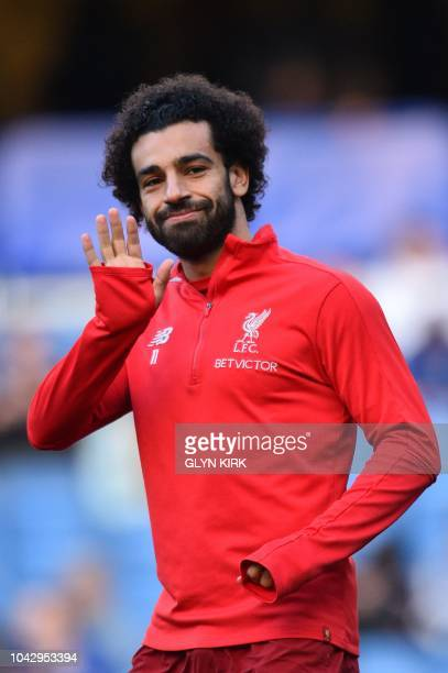 Liverpool's Egyptian midfielder Mohamed Salah warms up before the English Premier League football match between Chelsea and Liverpool at Stamford...