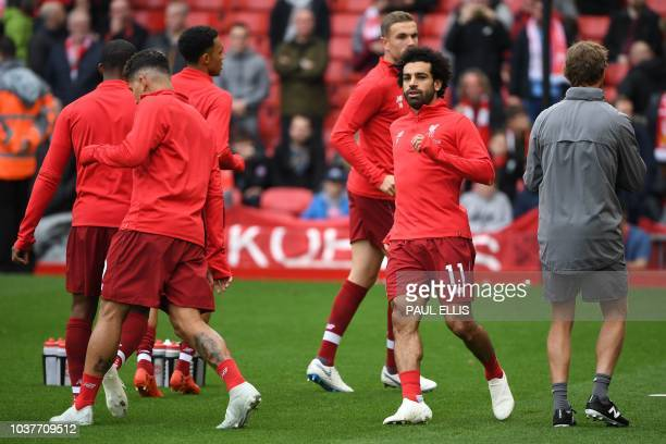 Liverpool's Egyptian midfielder Mohamed Salah warms up with teammates before the English Premier League football match between Liverpool and...
