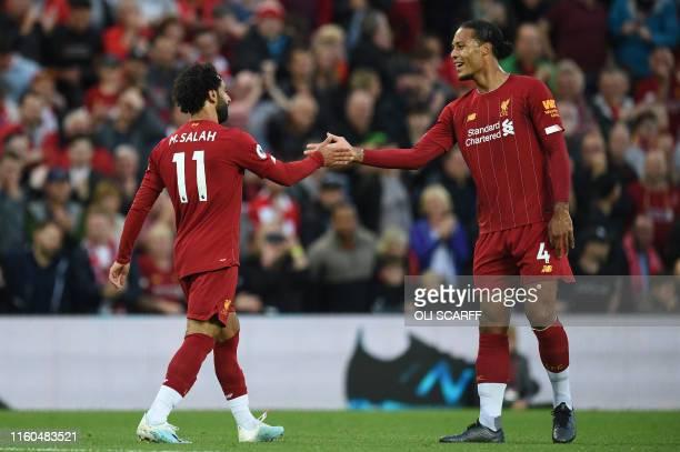 Liverpool's Egyptian midfielder Mohamed Salah with Liverpool's Dutch defender Virgil van Dijk celebrates after scoring the team's second goal during...