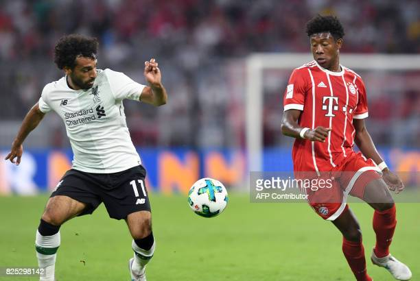 Liverpool's Egyptian striker Mohamed Salah and Bayern Munich's Austrian defender David Alaba vie for the ball during the second Audi Cup football...