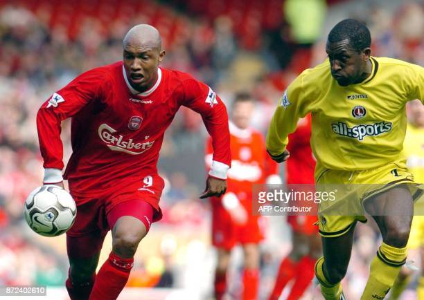 Liverpool's Elhadji Diouf and Charlton's Radostin Kishisev chase the ball during todays Premiership football match at Anfield Liverpool 12 April 2004...