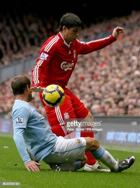 Liverpool's Emiliano Insua and Manchester City's Pablo Zabaleta battle for the ball