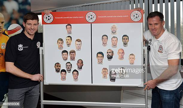 Liverpool's English captain and midfielder Steven Gerrard and former Liverpool team mate Jamie Carragher present a board with the players in their...
