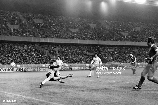 Liverpool's English defender Alan Kennedy scores a goal past Real Madrid's Spanish goalkeeper Agustin during the European Cup final football match...