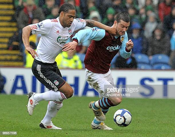 Liverpool's English defender Glen Johnson vies with Burnley's English striker David Nugent during the English Premier League football match between...