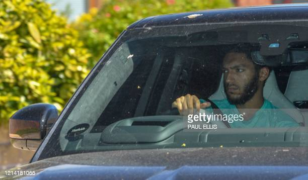 Liverpool's English defender Joe Gomez arrives at Melwood in Liverpool north west England to resume training on May 20 as training resumes after the...