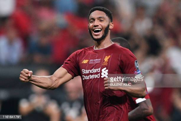 Liverpool's English defender Joe Gomez celebrates after Liverpool won the UEFA Super Cup 2019 football match between FC Liverpool and FC Chelsea at...