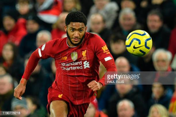 Liverpool's English defender Joe Gomez chases the ball during the English Premier League football match between Liverpool and Wolverhampton Wanderers...