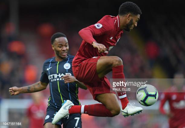 Liverpool's English defender Joe Gomez controls the ball away from the path of Manchester City's English midfielder Raheem Sterling during the...