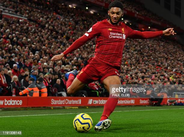 Liverpool's English defender Joe Gomez controls the ball during the English Premier League football match between Liverpool and Sheffield United at...