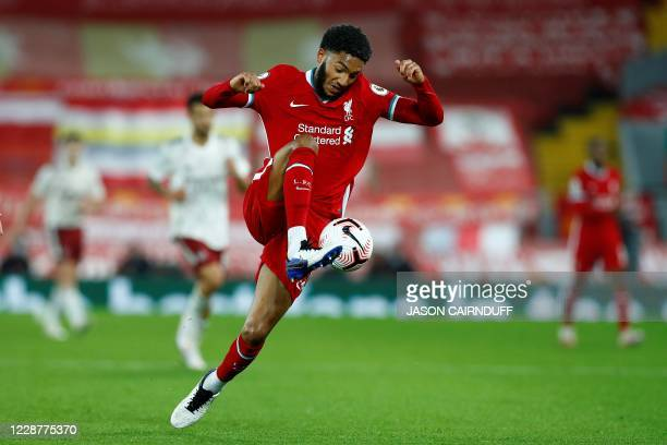 Liverpool's English defender Joe Gomez controls the ball during the English Premier League football match between Liverpool and Arsenal at Anfield in...