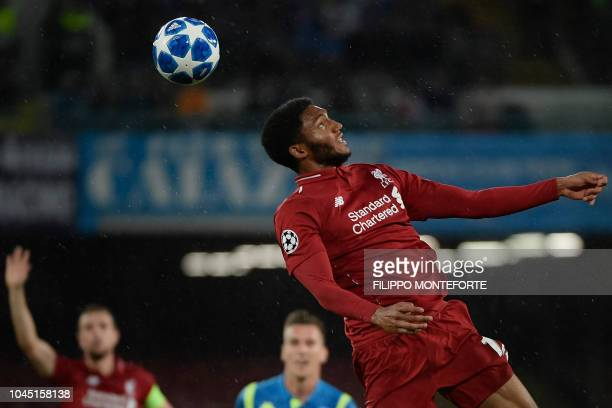 Liverpool's English defender Joe Gomez goes for a header during the UEFA Champions League group C football match between Napoli and Liverpool on...