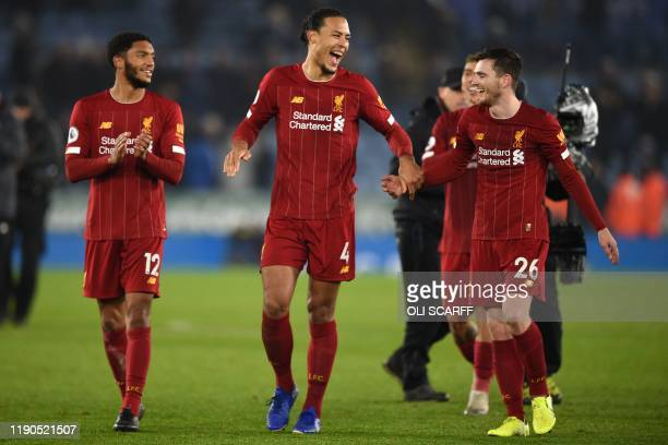Liverpool's English defender Joe Gomez Liverpool's Dutch defender Virgil van Dijk and Liverpool's Scottish defender Andrew Robertson celebrate on the...