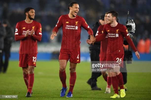 Liverpool's English defender Joe Gomez , Liverpool's Dutch defender Virgil van Dijk and Liverpool's Scottish defender Andrew Robertson celebrate on...