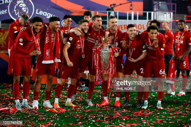 Liverpool's English defender Joe Gomez, Liverpool's English midfielder Alex Oxlade-Chamberlain, Liverpool's English midfielder Adam Lallana,...