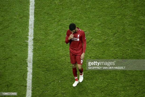 Liverpool's English defender Joe Gomez reacts after the UEFA Champions League Group C football match between Paris SaintGermain and Liverpool FC at...