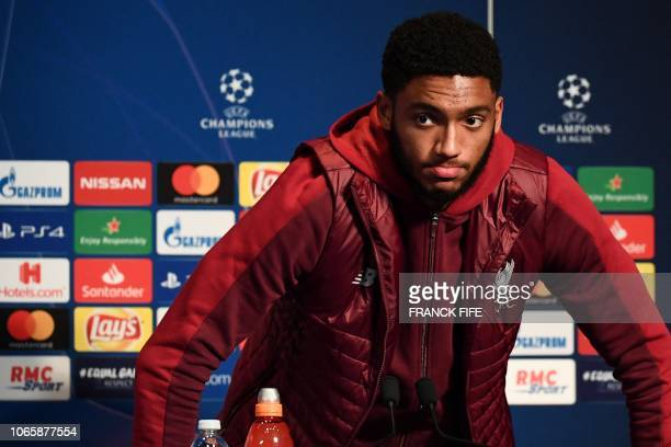 Liverpool's English defender Joe Gomez reacts as he leaves after a press conference at the Parc des Princes stadium in Paris on November 27 2018 on...