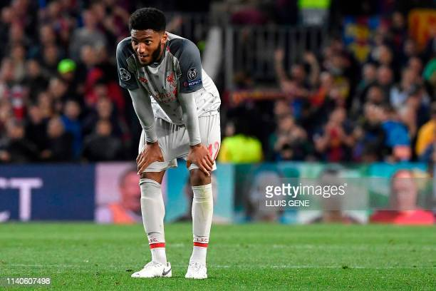 Liverpool's English defender Joe Gomez reacts at the end of the UEFA Champions League semi-final first leg football match between Barcelona and...