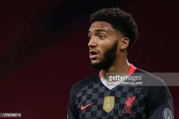 Liverpool's English defender Joe Gomez reacts during the UEFA Champions League Group D firstleg football match between Ajax Amsterdam and Liverpool...
