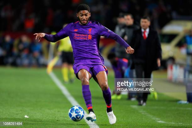 Liverpool's English defender Joe Gomez runs with the ball during the UEFA Champions League Group C secondleg football match between Red Star Belgrade...