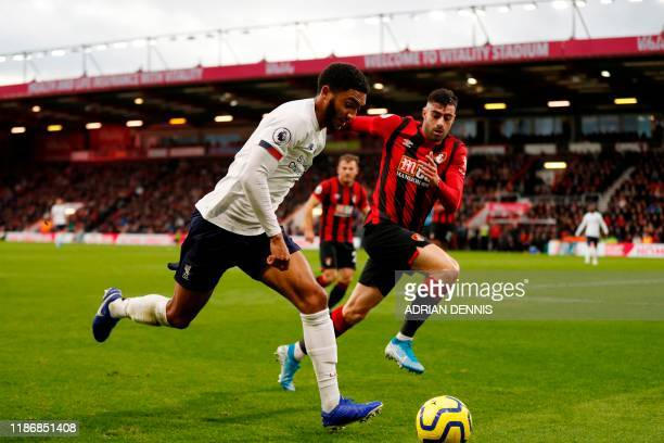 Liverpool's English defender Joe Gomez runs with the ball during the English Premier League football match between Bournemouth and Liverpool at the...