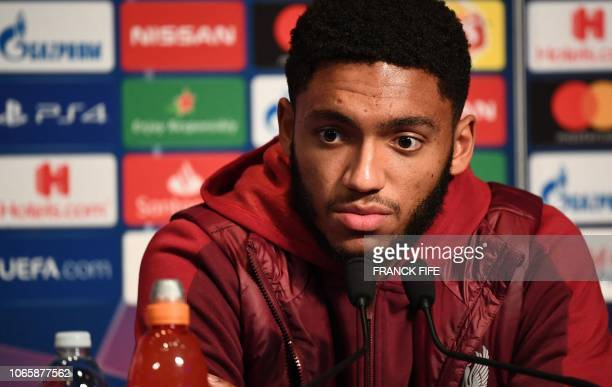 Liverpool's English defender Joe Gomez speaks during a press conference at the Parc des Princes stadium in Paris on November 27, 2018 on the eve of...