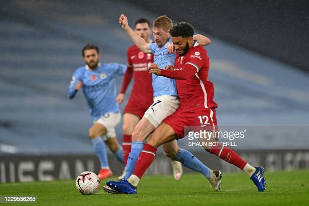 Liverpool's English defender Joe Gomez tackles Manchester City's Belgian midfielder Kevin De Bruyne during the English Premier League football match...