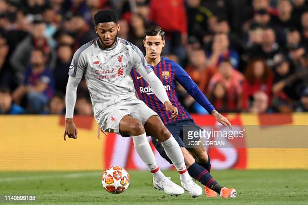 Liverpool's English defender Joe Gomez vies with Barcelona's Brazilian midfielder Philippe Coutinho during the UEFA Champions League semifinal first...