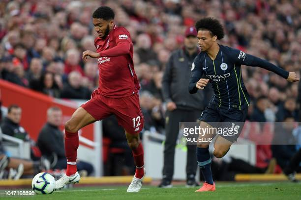 Liverpool's English defender Joe Gomez vies with Manchester City's German midfielder Leroy Sane during the English Premier League football match...