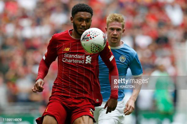 Liverpool's English defender Joe Gomez vies with Manchester City's Belgian midfielder Kevin De Bruyne during the English FA Community Shield football...
