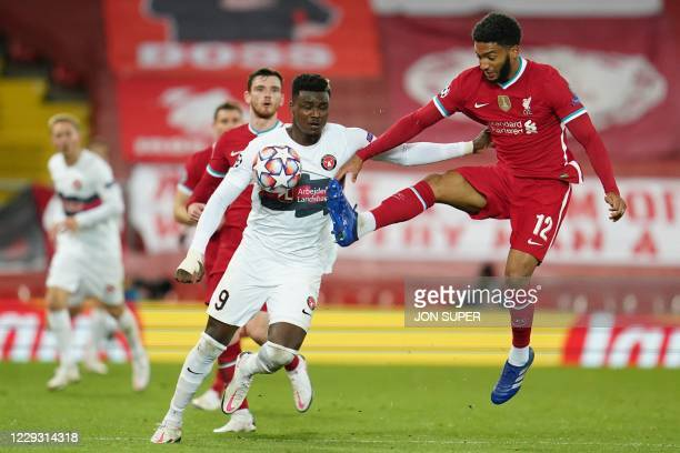 Liverpool's English defender Joe Gomez vies with Midtjylland's Guinean forward Sory Kaba during the UEFA Champions league Group D football match...