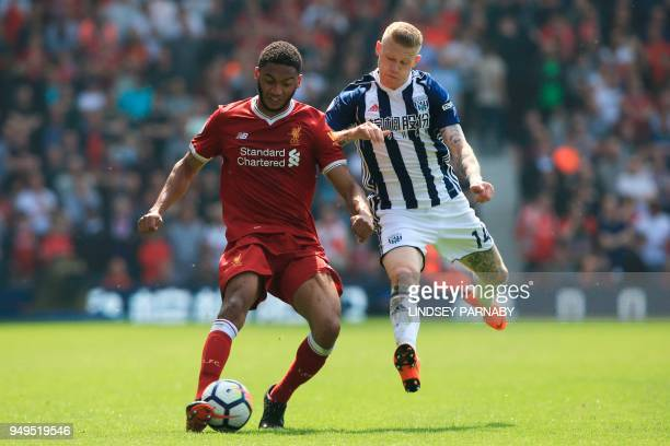 Liverpool's English defender Joe Gomez vies with West Bromwich Albion's Irish midfielder James McClean during the English Premier League football...