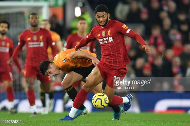 Liverpool's English defender Joe Gomez vies with Wolverhampton Wanderers' Portuguese midfielder Pedro Neto during the English Premier League football...