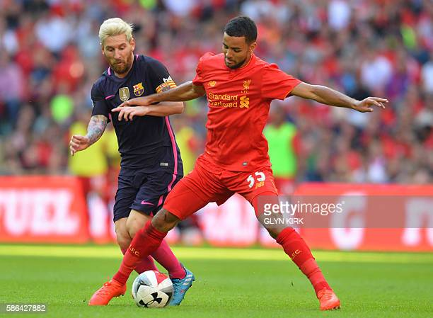 Liverpool's English defender Kevin Stewart vies with Barcelona's Argentinian striker Lionel Messi during the preseason International Champions Cup...