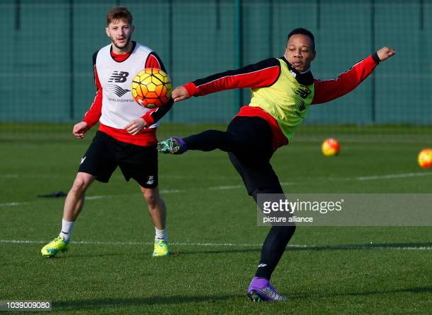 Liverpool's English defender Nathaniel Clyne and Liverpool's English midfielder Adam Lallana in action during team training session at the Melwood...