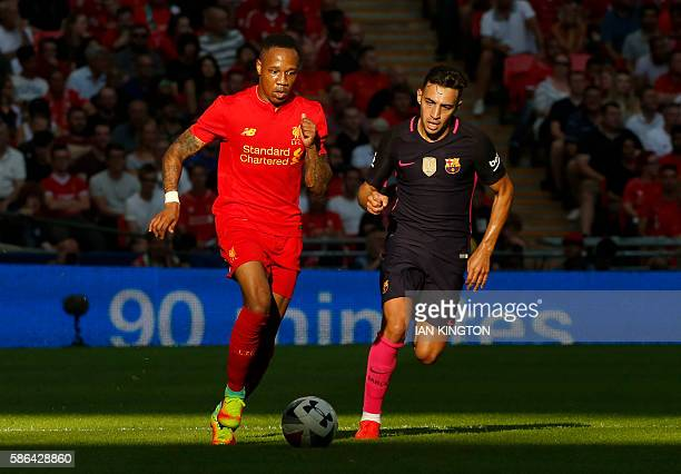 Liverpool's English defender Nathaniel Clyne vies with Barcelona's Spanish striker Munir El Haddadi during the preseason International Champions Cup...