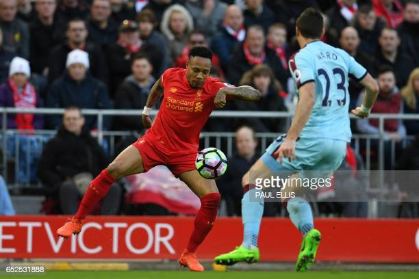Liverpool's English defender Nathaniel Clyne vies with Burnley's Irish defender Stephen Ward during the English Premier League football match between...