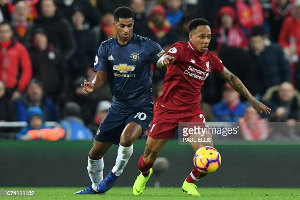 Liverpool's English defender Nathaniel Clyne vies with Manchester United's English striker Marcus Rashford during the English Premier League football...