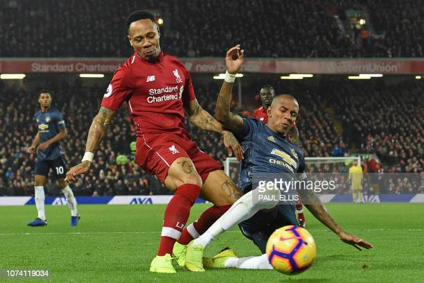 Liverpool's English defender Nathaniel Clyne vies with Manchester United's English midfielder Ashley Young during the English Premier League football...
