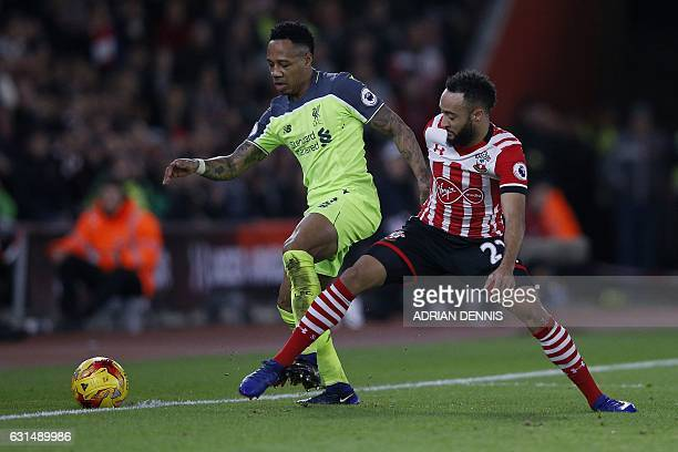 Liverpool's English defender Nathaniel Clyne vies with Southampton's English midfielder Nathan Redmond during the EFL Cup semifinal firstleg football...