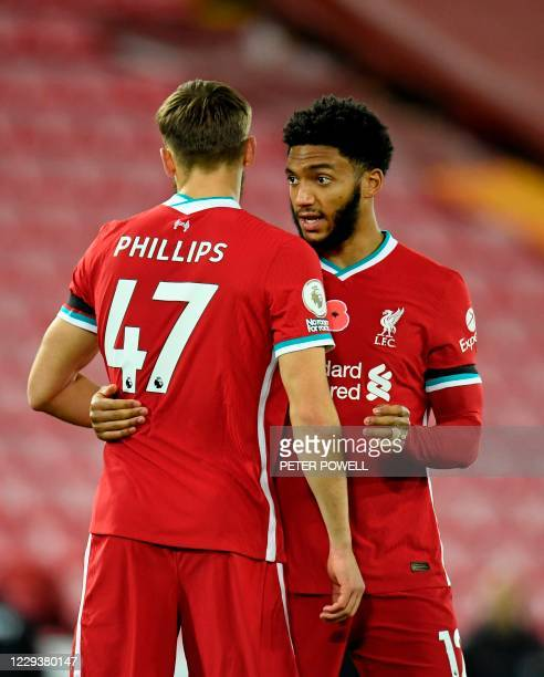Liverpool's English defender Nathaniel Phillips and Liverpool's English defender Joe Gomez greet each other during the English Premier League...