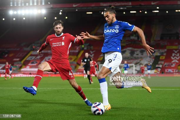 Liverpool's English defender Nathaniel Phillips vies with Everton's English striker Dominic Calvert-Lewin during the English Premier League football...