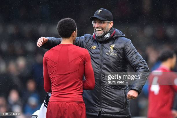 Liverpool's English defender Trent AlexanderArnold and Liverpool's German manager Jurgen Klopp gesture after the English Premier League football...