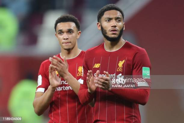 Liverpool's English defender Trent AlexanderArnold and Liverpool's English defender Joe Gomez greet the fans following the 2019 FIFA Club World Cup...