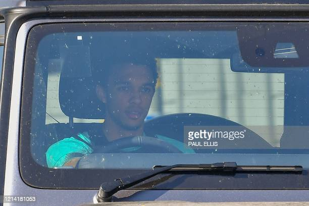 Liverpool's English defender Trent AlexanderArnold arrives at Melwood in Liverpool north west England to resume training on May 20 as training...