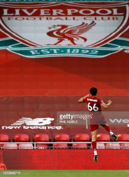 Liverpool's English defender Trent AlexanderArnold celebrates scoring the opening goal during the English Premier League football match between...